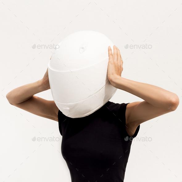 Model in the helmet. Minimal art fashion. - Stock Photo - Images