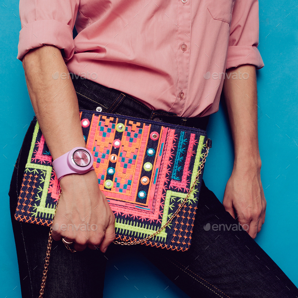 Girl in a pink shirt and fashion accessories. Bag and stylish bl - Stock Photo - Images