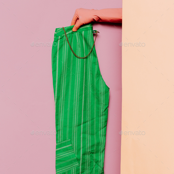 Stylish clothes. Summer green pants. Strip print trend wardrobe - Stock Photo - Images