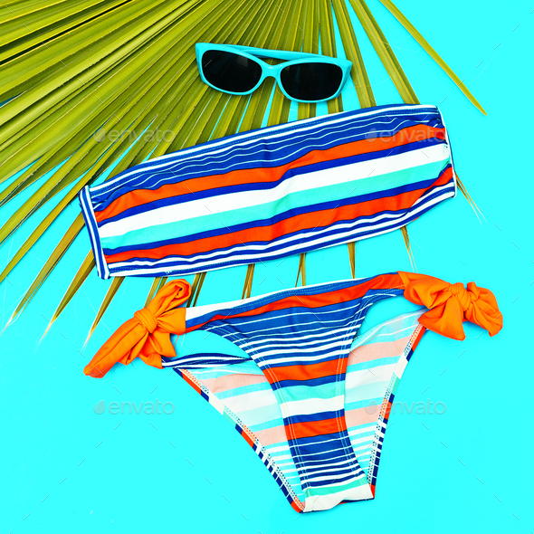 Stylish beach outfit Swimsuit and accessories - Stock Photo - Images