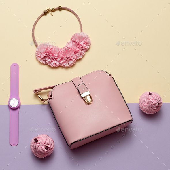 Ladies Fashion Accessories. Pink bag, watch, necklace. Pastel co - Stock Photo - Images