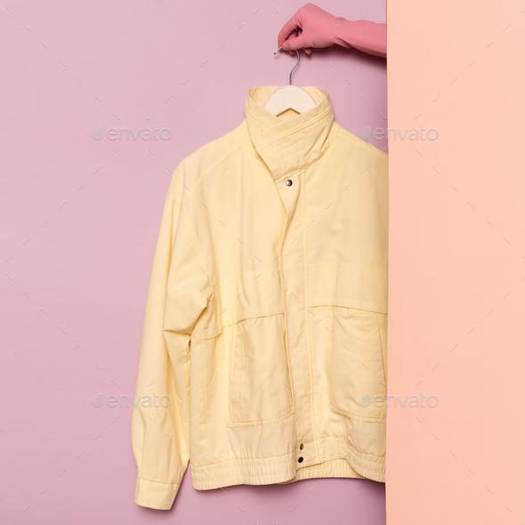 Stylish sportswear. Vintage Jacket. Minimal fashion. On the hang - Stock Photo - Images
