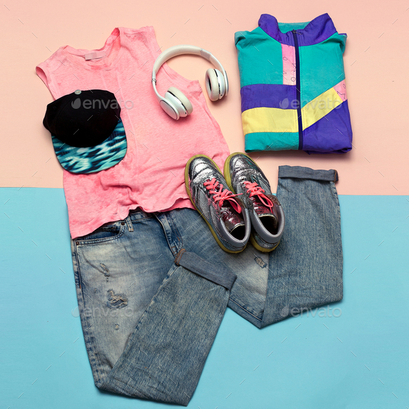 Stylish set. Fashionable jeans and sneakers. Accessories Headpho - Stock Photo - Images