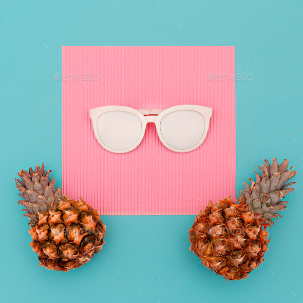 Two pineapples and sunglasses. Beach concept. Minimal art design - Stock Photo - Images