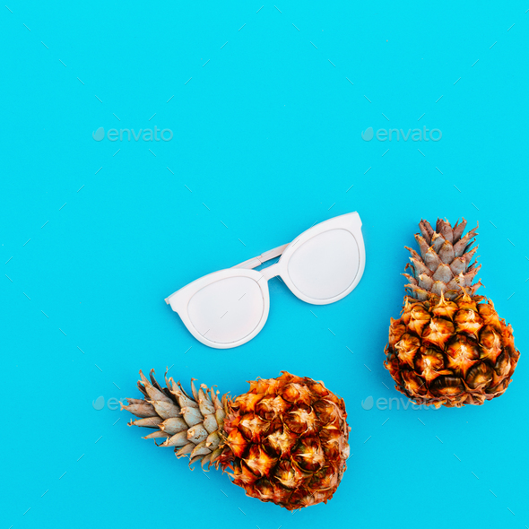 Sunglasses and pineapples. Fashion accessory of the summer. - Stock Photo - Images