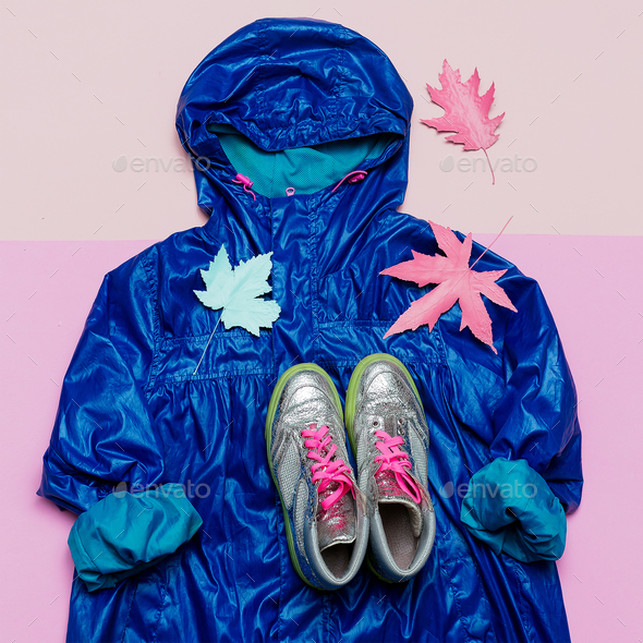 Cloak and sneakers. Hello Rains Season. Urban street fashion. Mi - Stock Photo - Images
