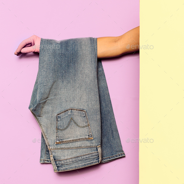 Stylish clothes. Flared jeans. Denim. Minimal fashion. Wardrobe - Stock Photo - Images