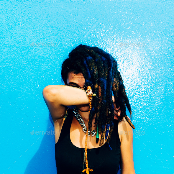 Rasta Latino Girl with dreadlocks, piercings, tattoos and stylis - Stock Photo - Images