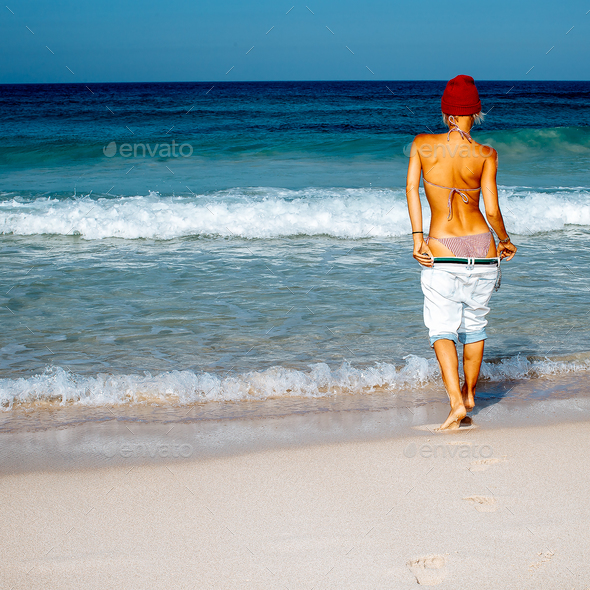 Girl traveler. Beach style fashion. Freedom Minimal - Stock Photo - Images