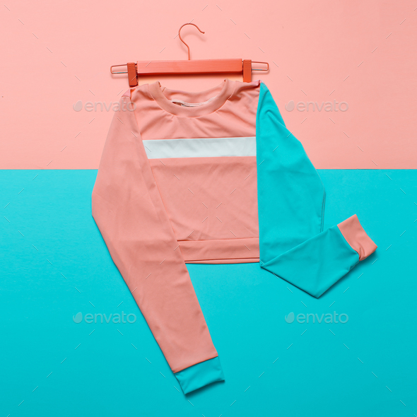 Stylish sports blouse on the hanger. Hipster style. Pastel color - Stock Photo - Images