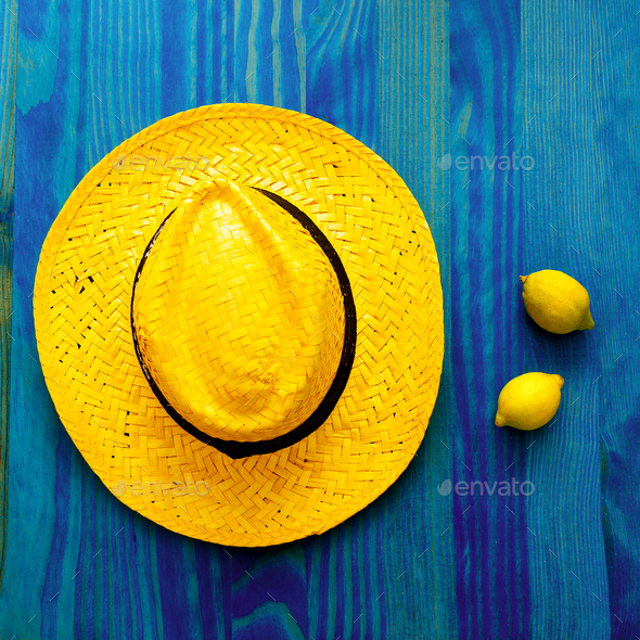 Lemon and straw hat. Tequila. Tropical Minimal. Fresh ideas - Stock Photo - Images