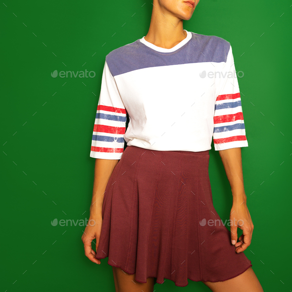 Girl in a T-shirt and a skirt. Vintage fashion skateboard style - Stock Photo - Images