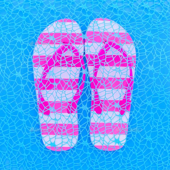 Flip flop and blue background. Ocean vibration. Minimal art - Stock Photo - Images