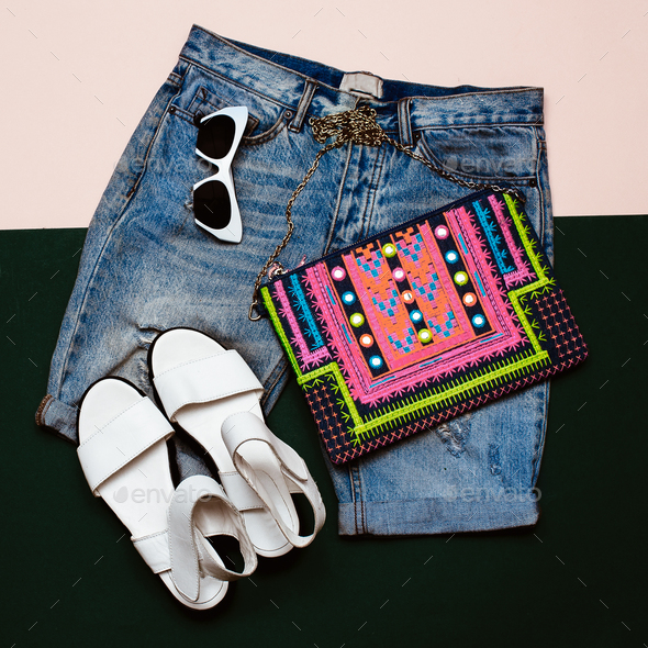 Stylish denim set. Denim shorts sandals and clutch. Bright Summe - Stock Photo - Images