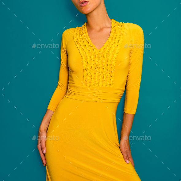 Lady in a yellow vintage dress. Retro fashion chic - Stock Photo - Images