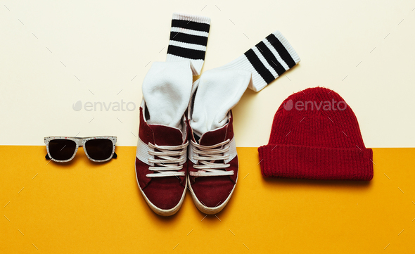 Urban Style Clothing. Skateboard fashion outfit. Beanie, socks, - Stock Photo - Images
