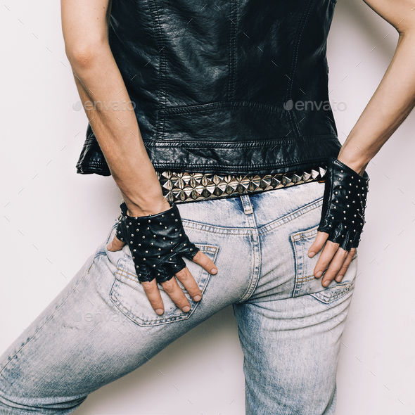 Stylish Model Rock Urban fashion jeans, vest, gloves accessories - Stock Photo - Images