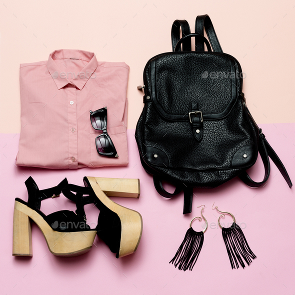 Stylish Lady Outfit pink shirt and black accessories, fashionabl - Stock Photo - Images