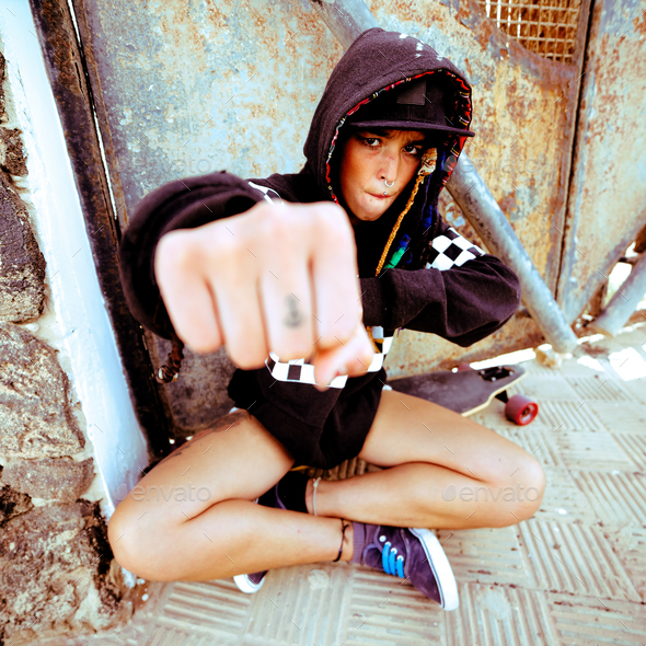 Young girl hip hop style. Urban street fashion. Skateboard life - Stock Photo - Images