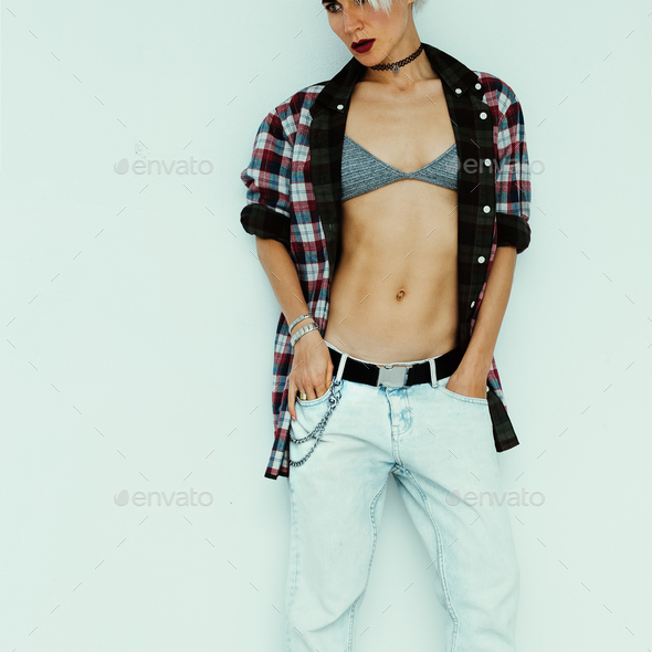 Casual summer fashion style. Tom boy model in stylish checkered - Stock Photo - Images