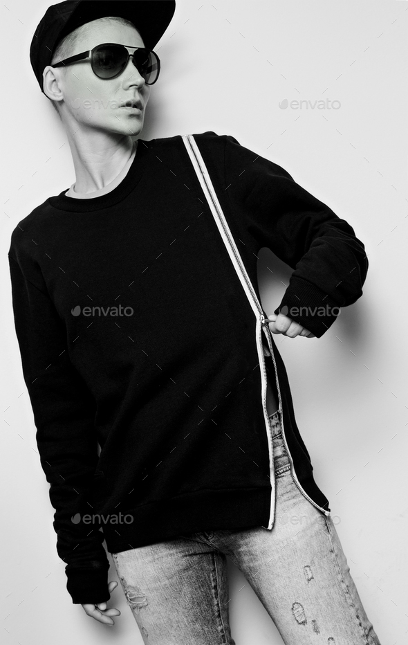 Tomboy style urban fashion model black outfit latest trends - Stock Photo - Images