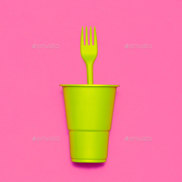 Plastic tableware. Minimal. Plastic cup and fork - Stock Photo - Images