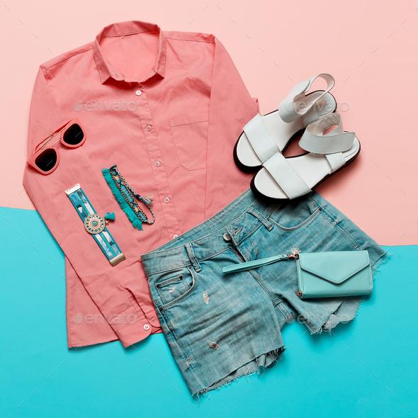 Stylish clothes. Pink jacket and denim shorts. Minimal. White Sa - Stock Photo - Images