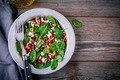 Fresh green salad with spinach, walnuts, goat cheese and pomegranate - PhotoDune Item for Sale