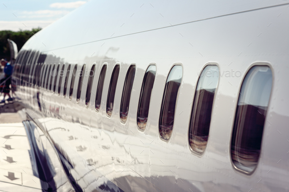 Airplane windows disembarking after arrival at vacation airport - Stock Photo - Images