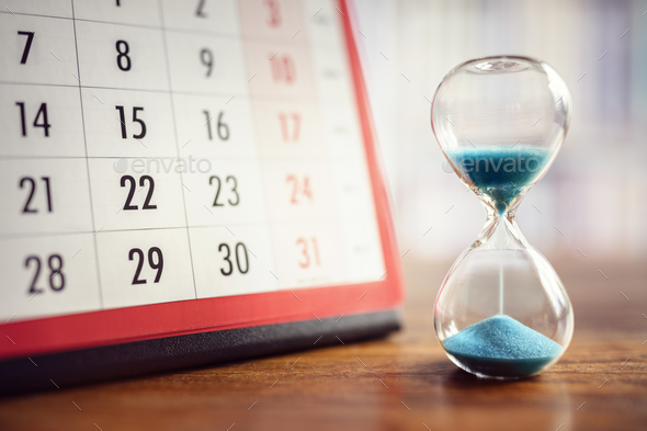 Hourglass and calendar - Stock Photo - Images