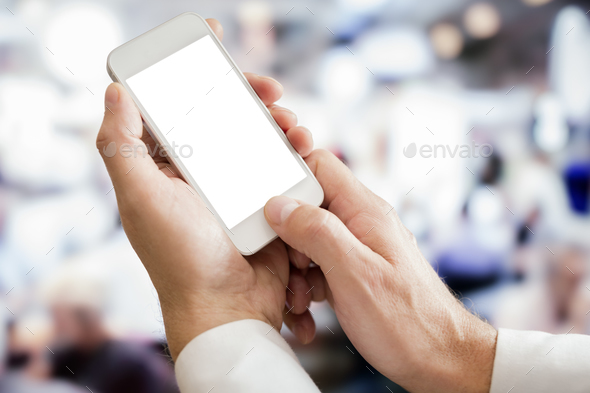 Businessman holding blank screen smartphone - Stock Photo - Images