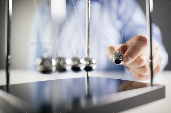 Newton's cradle businessman concept for cause and effect - Stock Photo - Images