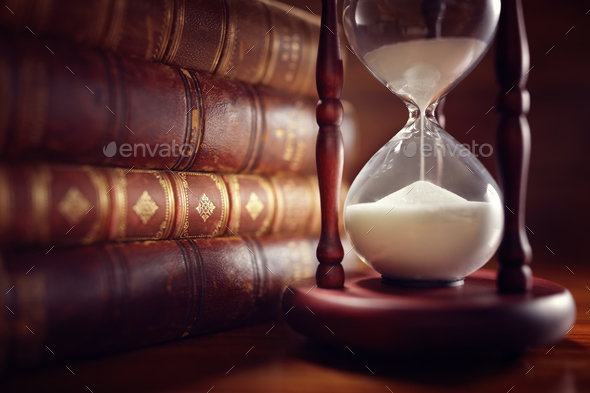 Old books and hourglass - Stock Photo - Images