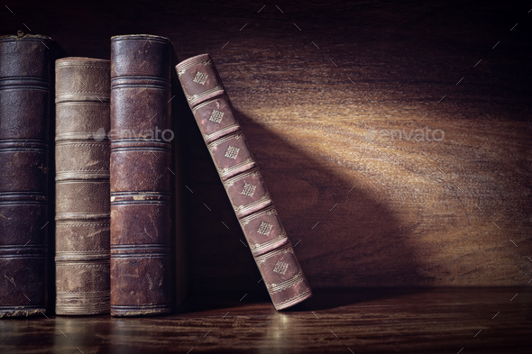 Old books on a library shelf background - Stock Photo - Images