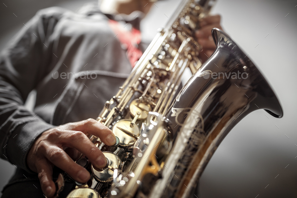 Saxophonist playing a saxophone - Stock Photo - Images