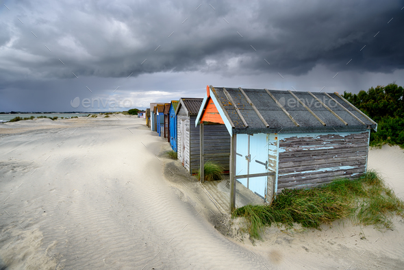 Beach Huts Under A Stormy Sky - Stock Photo - Images