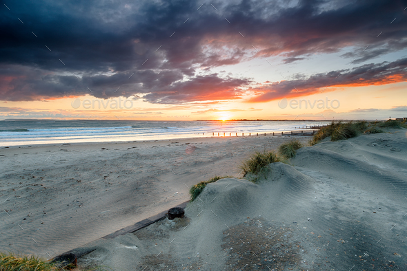 Stormy Sunset at West Wittering - Stock Photo - Images