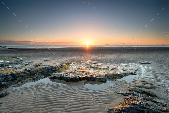 Sunrise in Bamburgh - Stock Photo - Images
