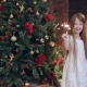 Little Girl with Fireworks Near a Christmas Tree - VideoHive Item for Sale