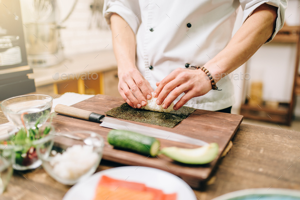 Sushi preparation, traditional japanese food - Stock Photo - Images