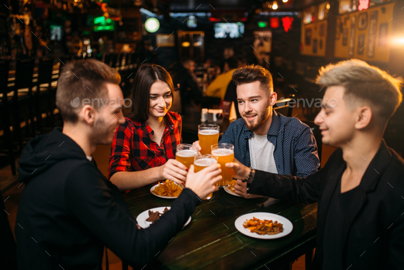 Group of friends having fun in a sport bar - Stock Photo - Images