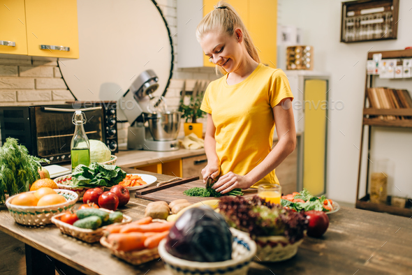 Housewife cooking, organic food preparation - Stock Photo - Images