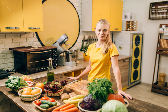 Young woman cooking on the kitchen, healthy food - Stock Photo - Images