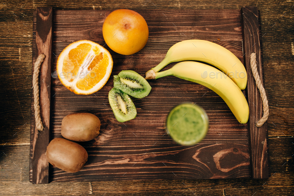 Fruits on wooden tray closeup, nobody, top view - Stock Photo - Images