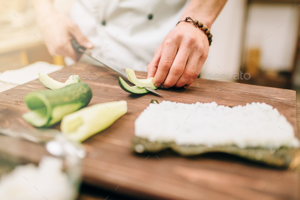 Male cook hands closeup, making sushi rolls - Stock Photo - Images