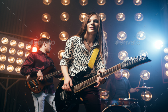 Musical performers on the stage in night club - Stock Photo - Images