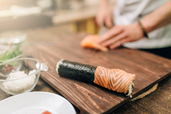Male person cooking seafood, asian kitchen - Stock Photo - Images