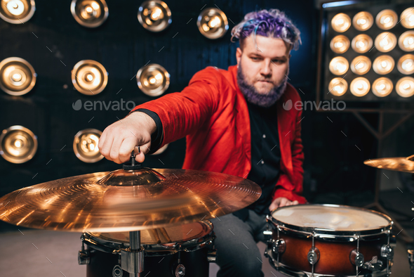 Bearded drummer in red suit on the stage - Stock Photo - Images
