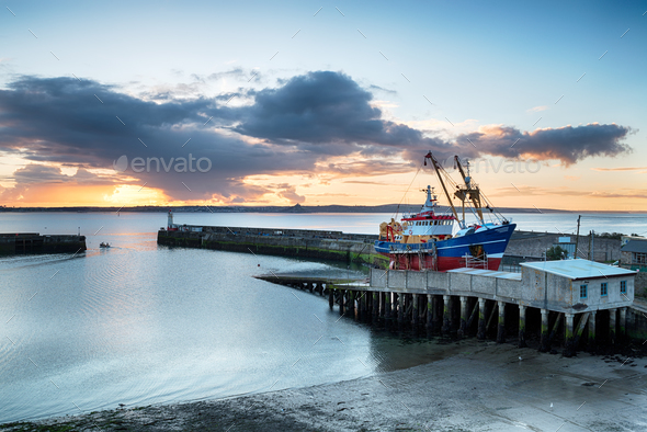 Sunrise over Newlyn Harbour - Stock Photo - Images