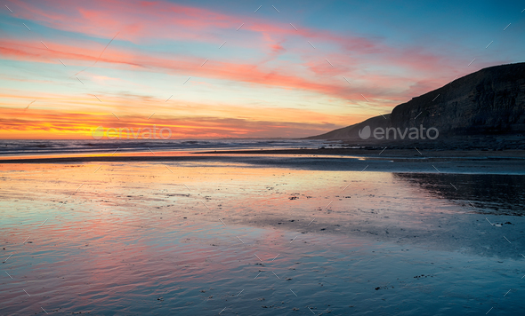 Sunset over the beach at Dunraven Bay - Stock Photo - Images